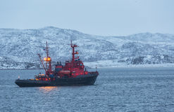 Fishing boat with lighted mast lights in the Barents Sea Royalty Free Stock Image