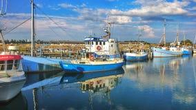 Fishing boat water reflection royalty free stock photos