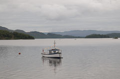 Fishing boat on Loch Lomond Royalty Free Stock Photo