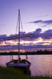 Fishing boat in Loire river at sunset Stock Photo