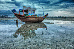 Fishing boat during low tide Stock Images