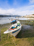 Fishing boat at low tide Royalty Free Stock Image