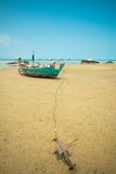 Fishing boat at low tide Royalty Free Stock Photo