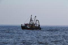 Serene Dawn Fishing Boat stock image