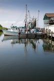 Fishing boat in marina. A fishing boat docked in a marina Stock Photo
