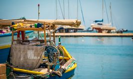 Fishing boat in Marsaxlokk. Colorful fishing boat in the bay near Marsaxlokk in Malta Royalty Free Stock Image