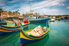 Fishing boat in Marsaxlokk. Colorful fishing boat in the bay near Marsaxlokk in Malta Stock Images