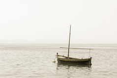 Fishing boat with a mast in sea Royalty Free Stock Photography
