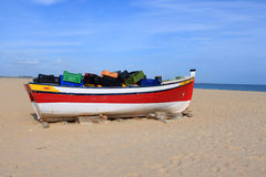 Fishing boat in Meia Praia, Lagos, Algarve, Portugal Stock Photo