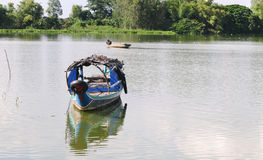 Fishing boat on Mekong river Royalty Free Stock Image