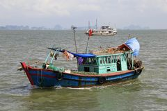 Fishing boat in the middle sea Royalty Free Stock Photography