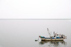 Fishing boat in the Mist Royalty Free Stock Image