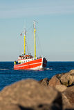 Fishing boat on the mole in Warnemuende Stock Photo