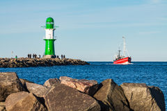 Fishing boat on the mole in Warnemuende Stock Photos