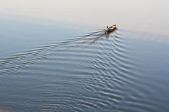 Fishing boat on Moon River in the morning Royalty Free Stock Photography