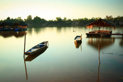 """Fishing boat. On the """"Moon River"""" in Thailand after sunset Royalty Free Stock Photo"""