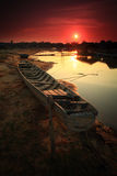 """Fishing boat. On the """"Moon River"""" in Thailand after sunset Stock Images"""