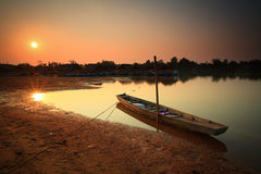 """Fishing boat. On the """"Moon River"""" in Thailand after sunset Stock Photography"""