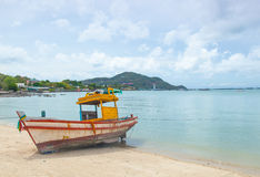 Fishing boat moored on the beach. Stock Photo