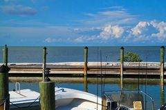 Fishing boat moored on dock in bay in Marathon Key royalty free stock image