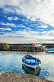 Fishing boat moored at the harbor of Acitrezza, Sicily stock images