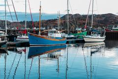 The fishing boat moored in a jettie in Lochinver Marina royalty free stock image