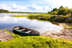 Fishing boat moored on the lake in the morning in summer Royalty Free Stock Images