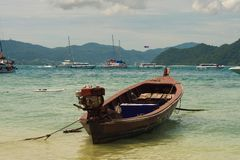 A fishing boat moored near the beach with white sandPhuket Islands - Coral Island Koh He Andaman Sea. A fishing boat moored near the beach with white sand Phuket Royalty Free Stock Photos