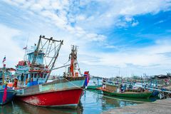 The fishing boat moored in the river access to the sea. stock photography
