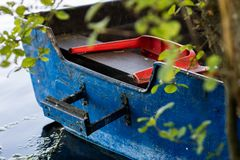 A fishing boat moored to the shore of the lake. Old fishermen& x27;s. Boat prepared for fishing on lakes. Season of the spring Royalty Free Stock Images