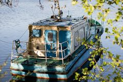 A fishing boat moored to the shore of the lake. Old fishermen& x27;s. Boat prepared for fishing on lakes. Season of the spring Royalty Free Stock Photography