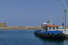 Fishing boat moored on the waterfront of Chania Royalty Free Stock Photo
