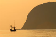 Fishing boat with morning light. Stock Photo