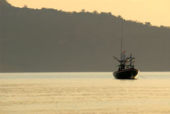 Fishing boat with morning light. Royalty Free Stock Photo