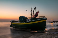 A fishing boat in the morning light Stock Photo
