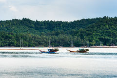Fishing boat in the morning sea Stock Photo