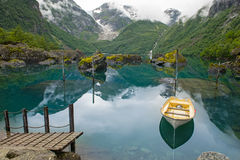 Fishing boat on mountain lake Norway Stock Photography