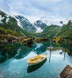 Fishing boat on mountain lake Norway Stock Photos