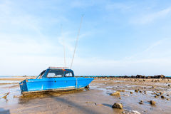 Fishing boat on the muck beach Royalty Free Stock Photo