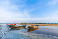 Fishing boat on the muck beach Royalty Free Stock Image