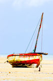 Fishing boat and muddy sand Royalty Free Stock Photos