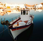 Fishing boat in Naoussa harbor Stock Photo