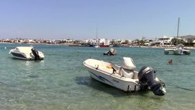 Fishing boat in Naxos island. Greek fishing boat anchored in the bay in Naxos island stock footage