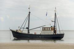 Fishing boat near the beach Stock Photos