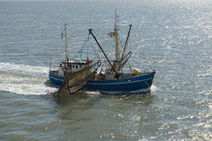 Fishing boat near the beach on the Dutch Wadden Sea Royalty Free Stock Image