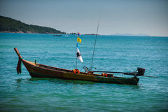 Fishing boat near coast. Picture of small fishing boat floating near coast line on a bright sunny day. Ko Bon, Thailand Stock Photos
