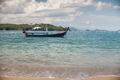 Fishing boat near coast. Picture of small fishing boat floating near coast line on a bright sunny day. Ko Bon, Thailand Royalty Free Stock Photography