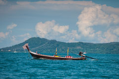 Fishing boat near coast. Picture of small fishing boat floating near coast line on a bright sunny day. Ko Bon, Thailand Royalty Free Stock Image