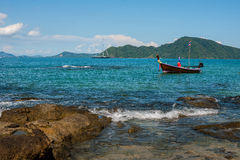 Fishing boat near coast. Picture of small fishing boat floating near coast line on a bright sunny day. Ko Bon, Thailand Stock Images