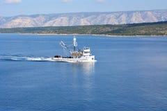 Fishing boat near the coast Stock Photography